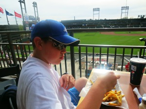 Mikey eating baseball